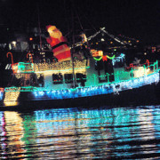 """Passengers aboard wave as a decorated boat passes during the Sausalito Yacht Club's 25th annual Lighted Boat Parade in Sausalito, Calif. on Saturday 8, 2012. About 40 boats cruised along the shoreline said Barbara """"Baba"""" Conroy with the yacht club. (Special to the IJ/Sherry LaVars)"""